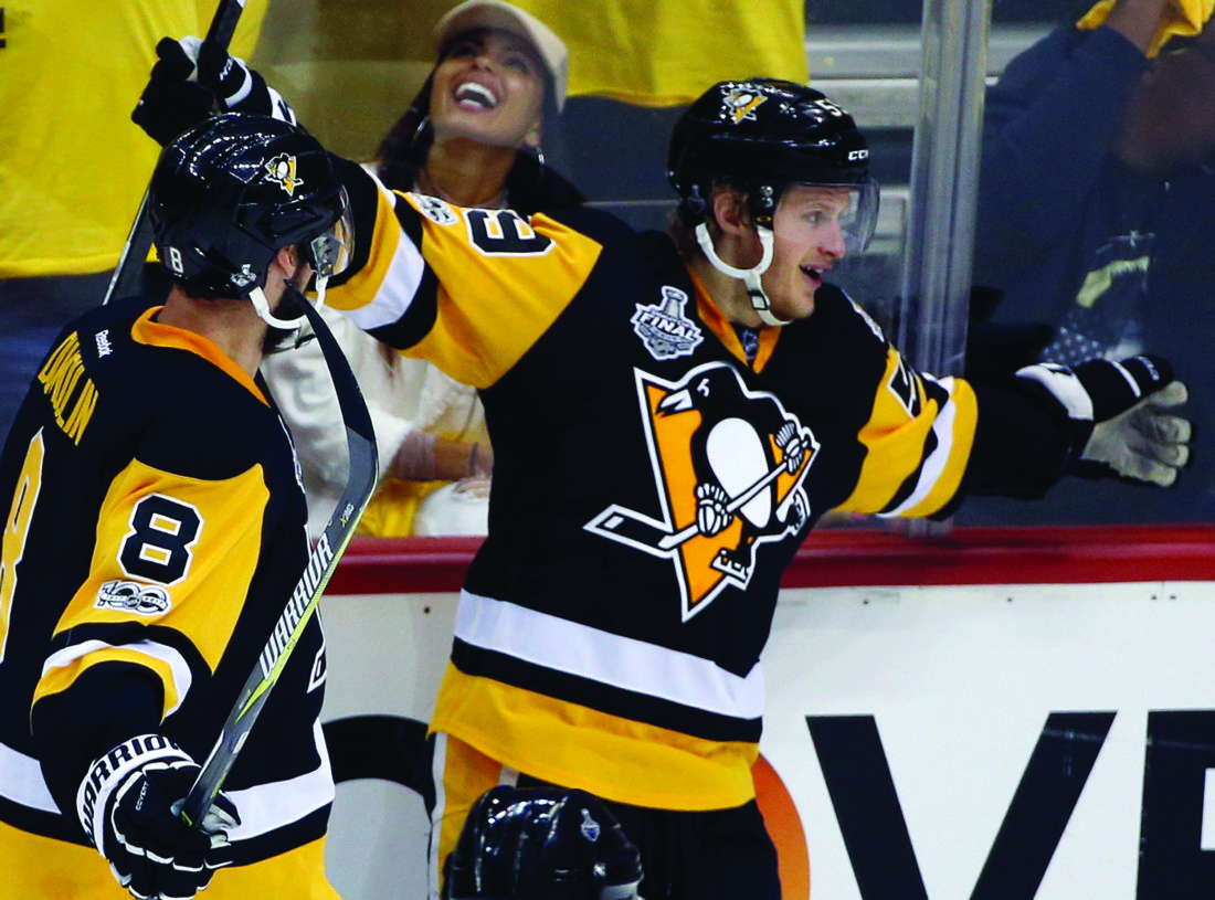 ... (59) celebrates his goal against the Nashville Predators with Brian  Dumoulin (8) during the third period in Game 2 of the NHL hockey Stanley Cup  Final a33429129