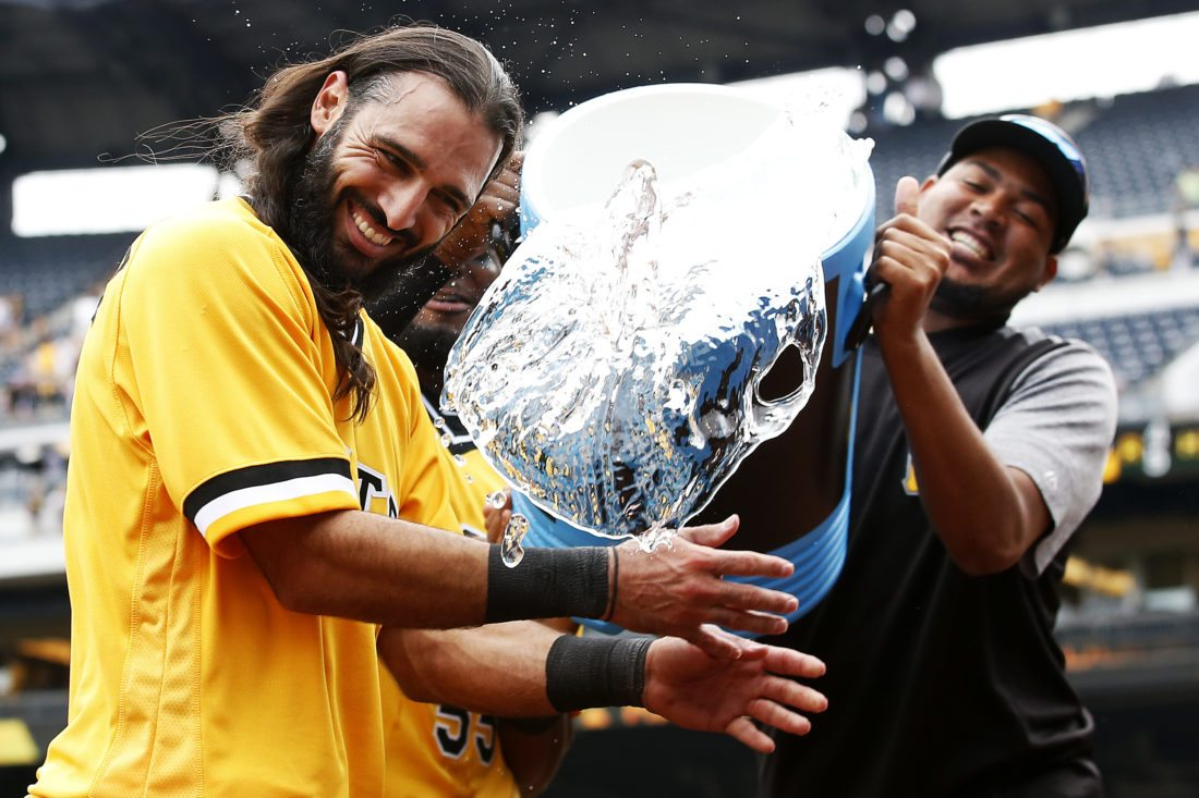 Pittsburgh Pirates first baseman Sean Rodriguez is drenched with water by teammate Ivan Nova after hitting the game-winning walk-off solo home run in the twelfth inning of a baseball game against the San Diego Padres in Pittsburgh, Sunday, Aug. 6, 2017. (AP Photo/Jared Wickerham)