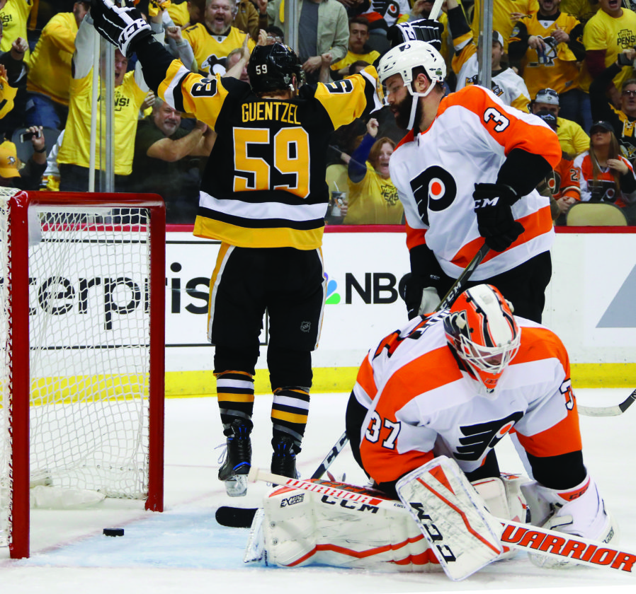 67743ca4b8a Pittsburgh Penguins  Jake Guentzel (59) celebrates his goal as Philadelphia  Flyers goaltender Brian Elliott (37) and Radko Gudas (3) collect themselves  ...