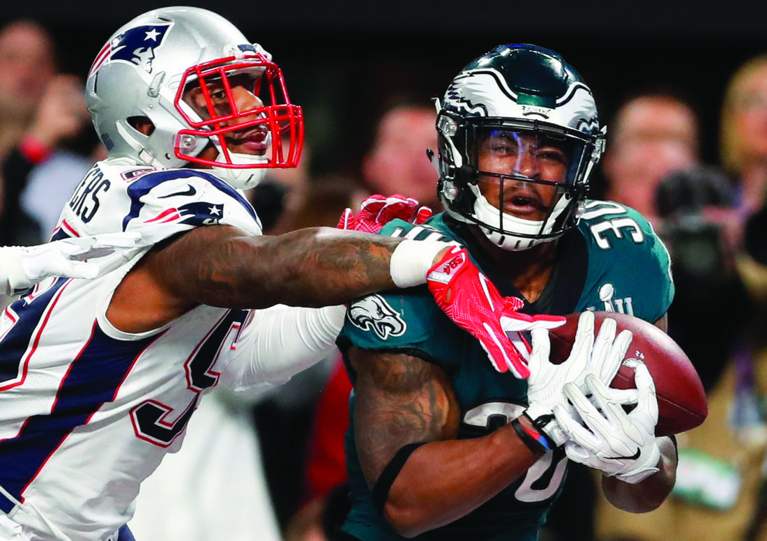 439383d6ebf 4, 2018, file photo, Philadelphia Eagles' Corey Clement, right, catches a  touchdown pass in front of New England Patriots' Marquis Flowers during the  second ...