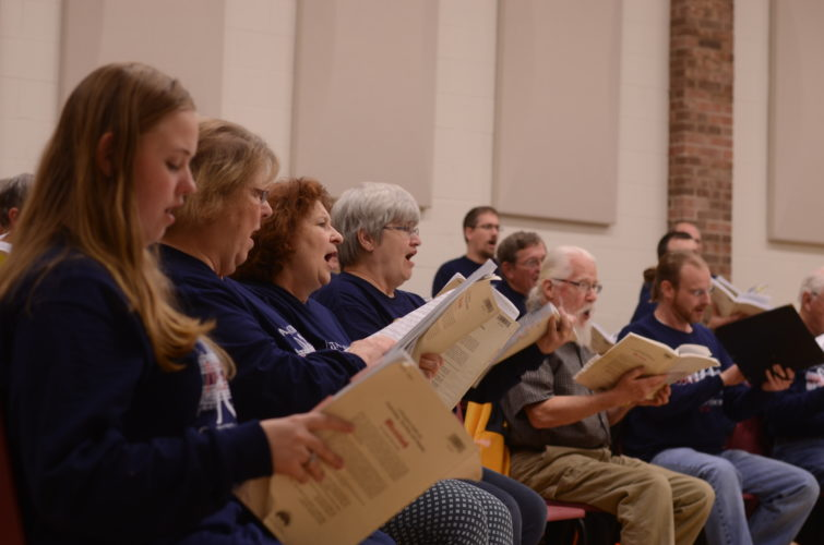 HANNAH KITTLE   The Marietta Times Betsy Guice-Ohse, 15, of Parkersburg, Ruth Heidorn, of Marietta, Sheree Alderman, 60, of Mineral Wells, and Mary Groves, 66, of Marietta, sing in Marietta College's Oratorio Chorus during rehearsal on Monday.