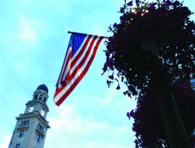 One of several flags flies along Putnam Street.