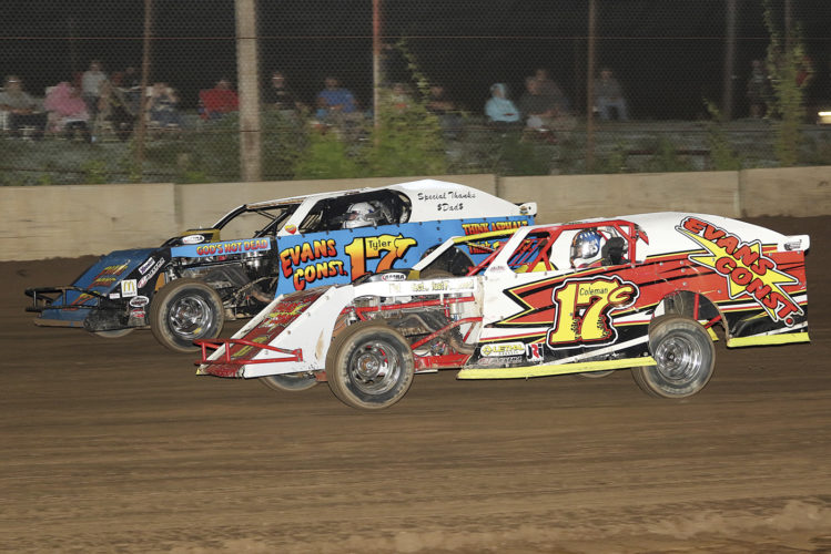 Coleman Evans (inside) looks to hold off older brother Tyler Evans (outside) for the lead in the 20-lap AMRA Modified feature Saturday night at The Legendary Hilltop Speedway. Tyler was able to make the pass and went on to claim his fourth win of the season on the quarter mile dirt track. Photo courtesy of Zach Yost.