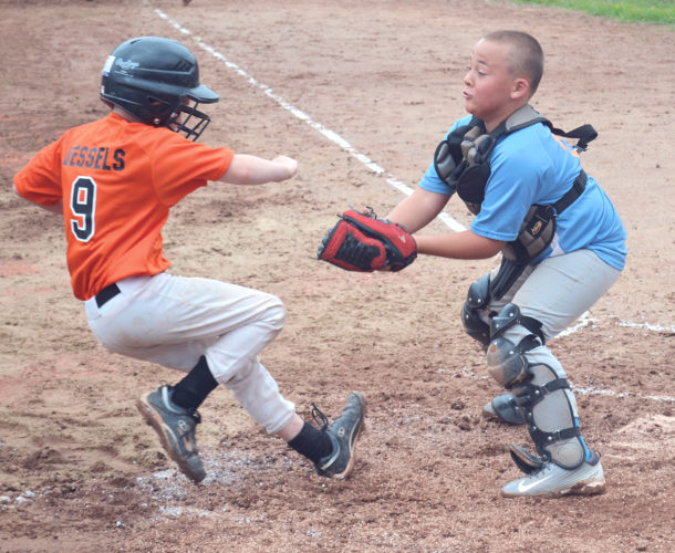 Marietta's Eli Vessels, left, is tagged out at the plate by Worthington Wildcats catcher Charlie Williams during 8U All-Star Tournament baseball action at the Worthington Ball Fields in Parkersburg Saturday. Photo by Ron Johnston.