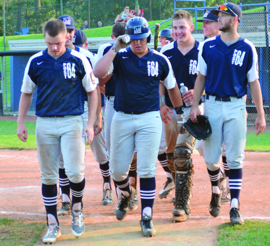 RON JOHNSTON The Marietta Times Marietta Post 64's Clay Hayes heads back to the dugout with his teammates after hitting a home run during an American Legion baseball game against St. Clairsville Post 159 Monday at Don Coss Field in Cambridge.