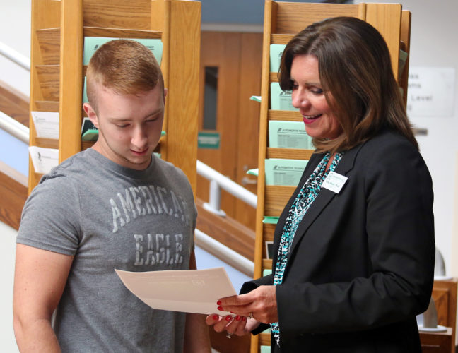 PEYTON NEELY   The Marietta Times Vicky Wood, president of Washington State Community College, meets with Frontier High School junior Seth Felton during his College Credit Plus advising meeting on Monday.