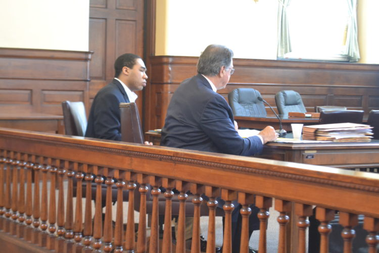 PEYTON NEELY   The Marietta Times Tyler Purvis-Mitchell, 23, of 2 Sard Road, Albany, N.Y., left, listens to  closing arguments with defense attorney George Cosenza in Judge Randall Burnworth's Common Pleas courtroom on Tuesday.