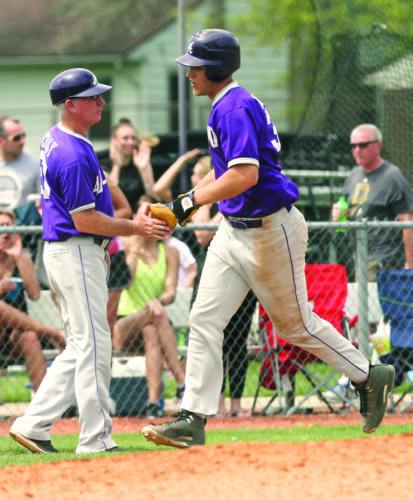 Courtesy photo Ashland University baseball coach John Schaly shakes hands with a player. Schaly has been selected to be inducted into the American Baseball Coaches Association Hall of Fame.
