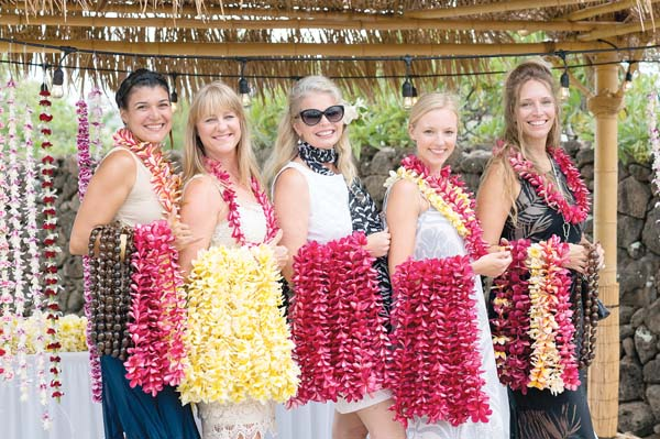 Lei greeters at the entrance of a previous Maui Calls are Manoa Ka'io Martin (from left), Emily Erickson, Ruth Goodfellow, Briana Liljestrand and Anna Comly, who warmly welcomed the attendees. Aubrey Hord photo