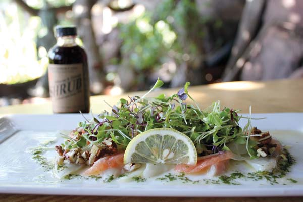 The first course of fresh Kona kampachi is artfully topped with Simpli-Fresh Farm Okinawan tatsoi, micro greens, grapefruit, pecans and Maui onion drizzled in cilantro olive oil, Maui Shrub Farm ginger and Hawaiian chili dressing. Photo courtesy Hyatt Maui