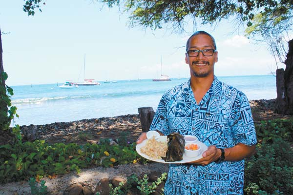 Aloha Mixed Plate manager Robert Lorenzo serves a sumo-sized Ali'i Plate with kalua pig, laulau, lomi lomi salmon, poi and haupia. The Maui News / CARLA TRACY photo