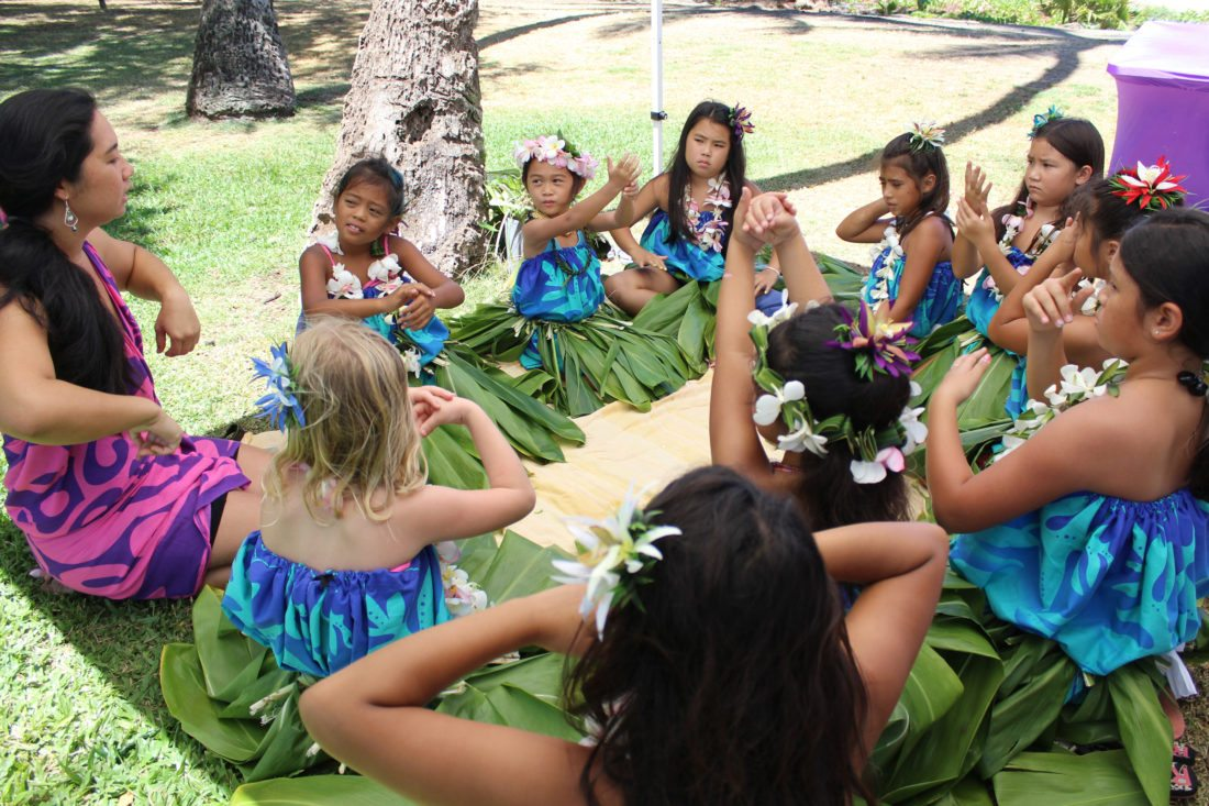 Ku'uipo Kaya, a kindergarten teacher for Paia Elementary and the school's Hawaiian immersion program, teaches hula to Aliyah Nitta (facing, with lei on head) and a group of Girl Scouts. • The Maui News / COLLEEN UECHI photo