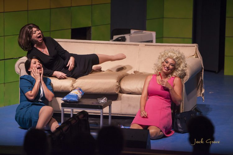 "Kathryn Holtkamp (from left on floor), Lina Aiko Krueger and Lia Krieg-DeSouza bond with a doobie after a bad day at the office in Maui OnStage's season finale   production of ""9 to 5 The Musical.""  • Jack Grace photo"