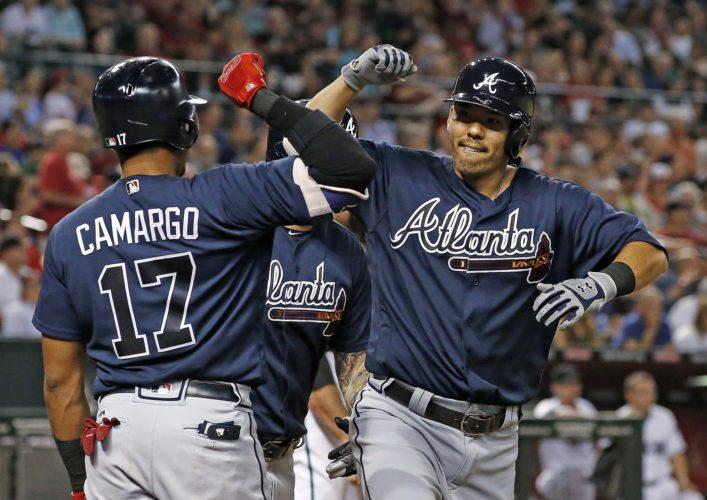 The Braves' Kurt Suzuki celebrates his two-run homer with Johan Camargo during the seventh inning Tuesday. •AP photo