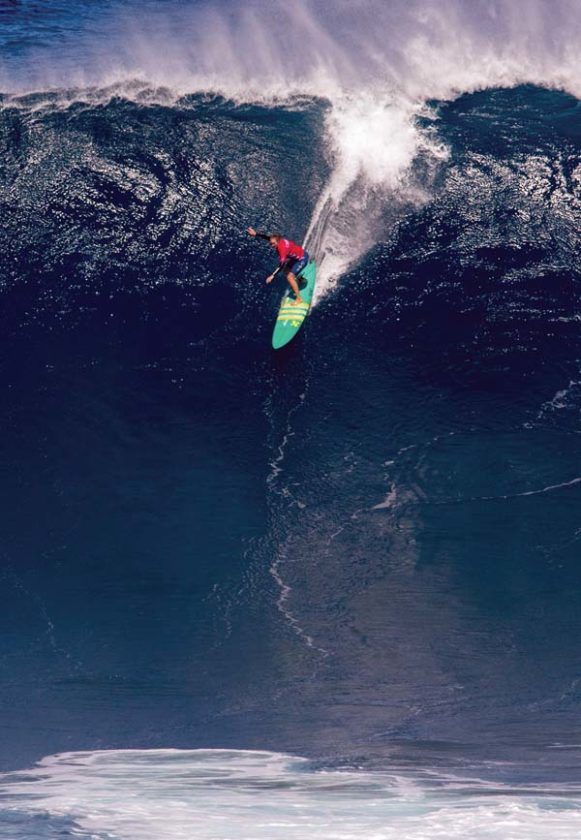 1179c1258f33 Paige Alms drops in during the Peahi Challenge. -- WORLD SURF LEAGUE photo