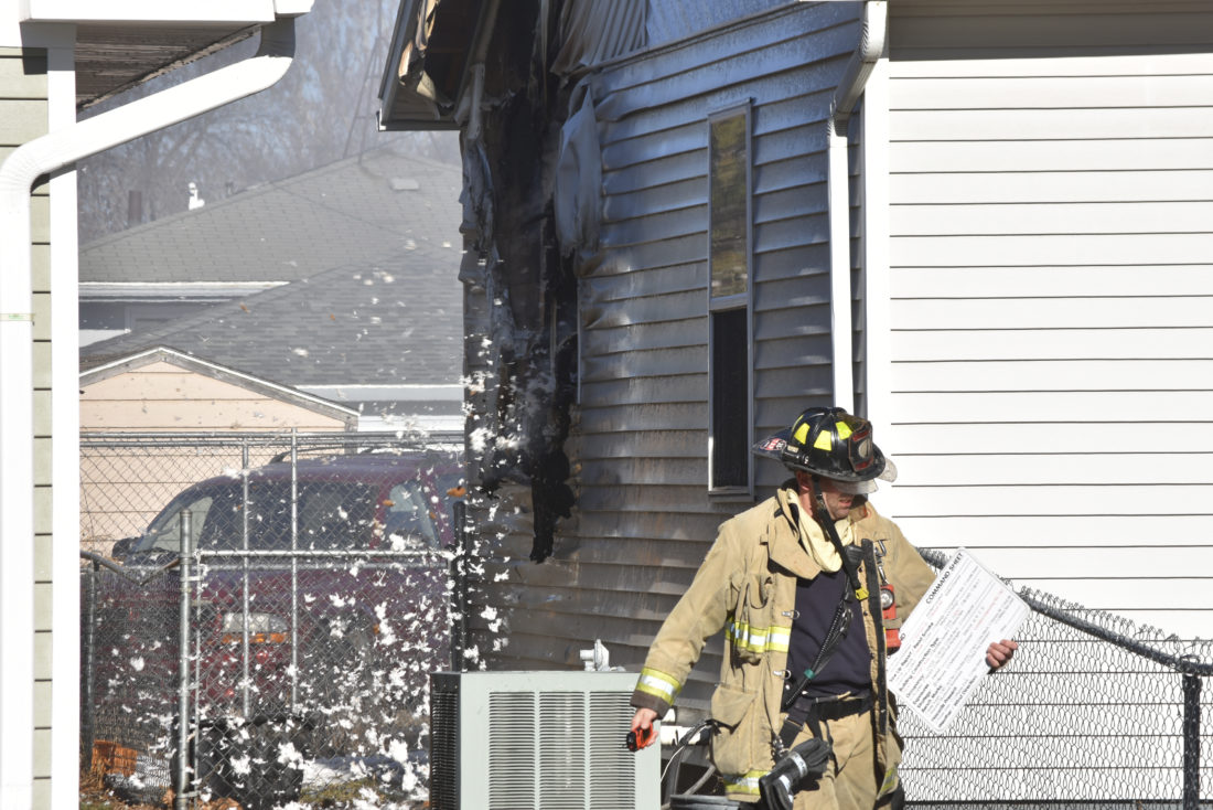 Fire damages adjacent FD homes, burning hole in one | News