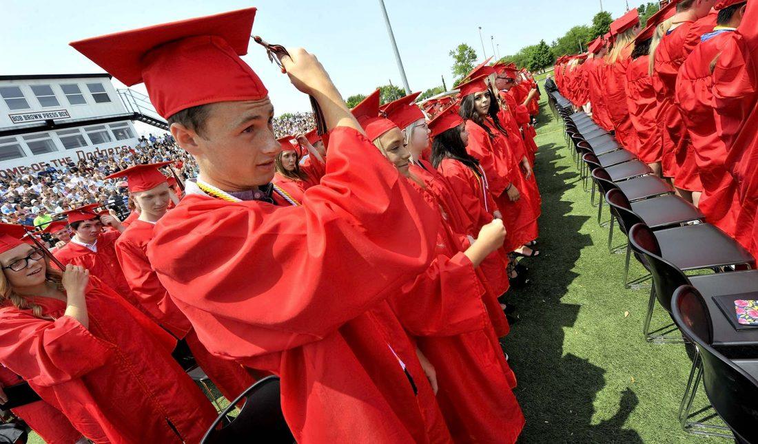 graduates move tassel on cap