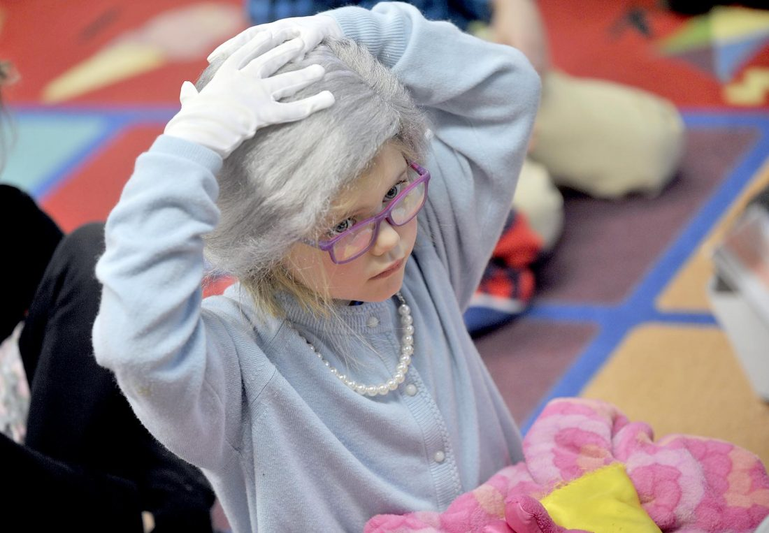 girl with wig dressed like she is 100 years old