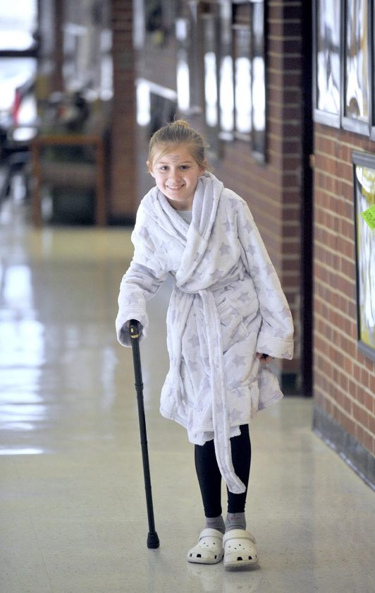 girl with cane dressed like she is 100 years old