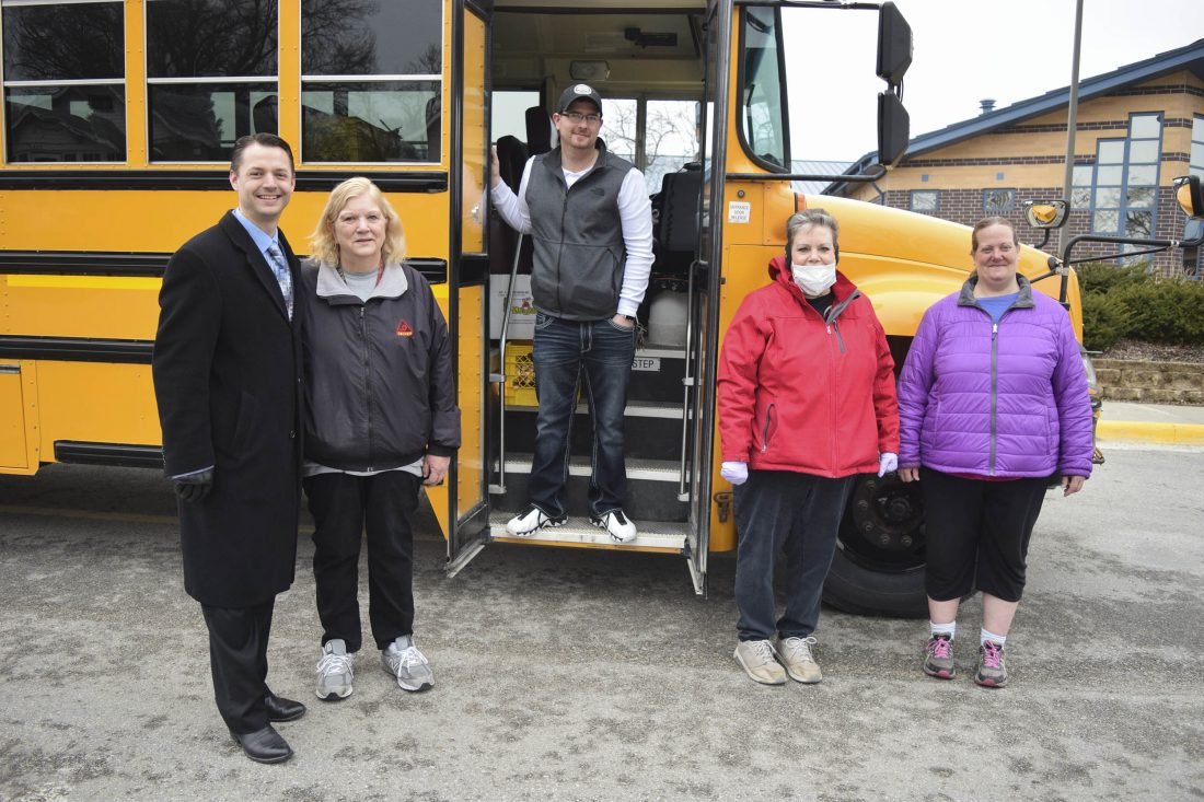 people standing outside school bus