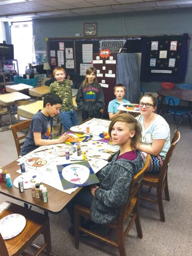Submitted Photo Fifth- and sixth-graders at Sawyer Elementary work on a Picasso art project on April 11. Sawyer will close its high school in the fall and many of its students will attend Max High School under a cooperative arrangement.