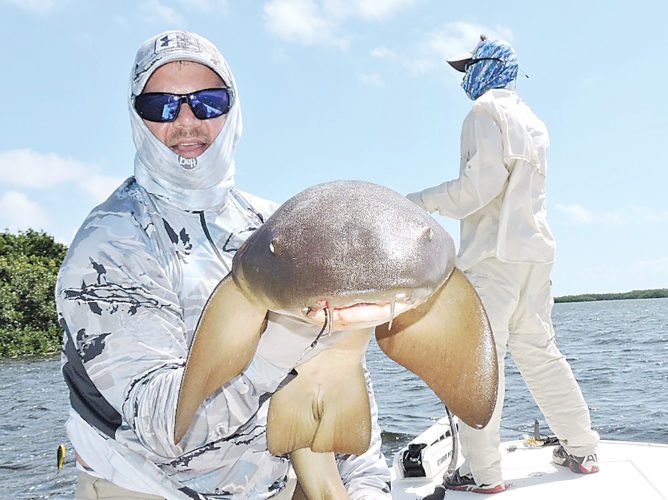 Kim Fundingsland/MDN Shane Goodman, Minot, landed this nurse shark on the famed flats near Key Largo, Florida. A variety of sharks frequently hunt in the shallow water.