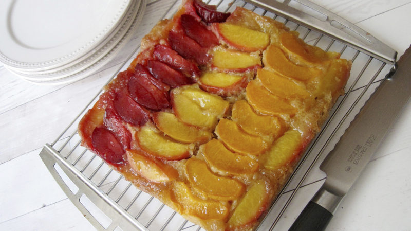This June 21, 2017 photo shows a stone fruit, almond upside down cake in New York. This dish is from a recipe by Sara Moulton. (Sara Moulton via AP)