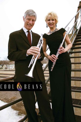 """Trumpeter, arranger and vocalist Steve Veikley stands beside flutist and vocalist Terri Aldrich. Veikley and Aldrich make up the jazz duo known as Cool Beans, who will perform at Oak Park during the Minot Area Council of the Arts, """"Arts in the Parks, 2017 Free Summer Concerts."""" Showtime starts at 7 p.m.  SubmittedPhoto"""