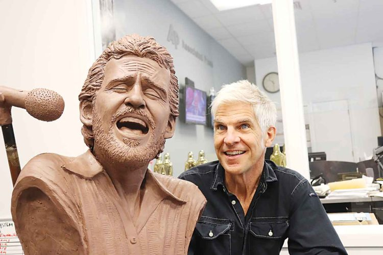AP Photo Sculptor Kevin Kresse appears with a bust he created of the late musician Levon Helm, Wednesday in Little Rock, Ark. The bust, once bronzed, will be part of a memorial to the performer, who grew up near Turkey Scratch in eastern Arkansas.
