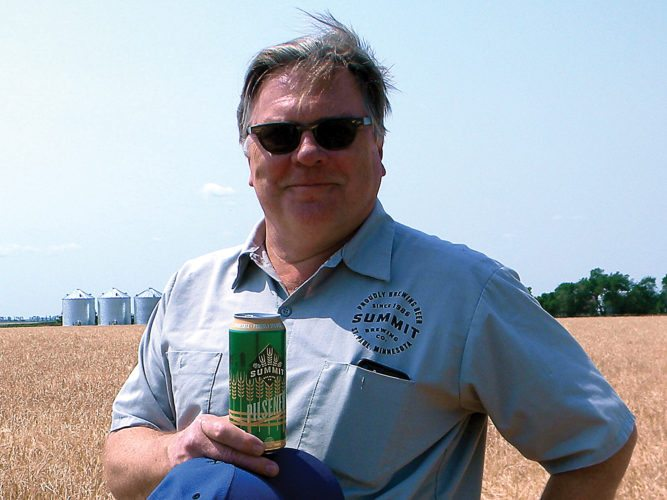 """Kent Olson/MDN """"It's a true North Dakota product,"""" Mark Stutrud, founder and president of Summit Brewing Co., said of his pilsner style beer, which is brewed with barley raised by his own family in the Rugby area."""