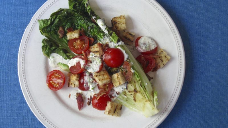 This July 26, 2017 photo shows a grilled BLT salad with buttermilk dressing in New York. This dish is from a recipe by Sara Moulton. (Sara Moulton via AP)
