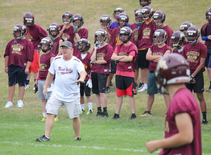 Alex Eisen/MDN Minot High football coach Barry Holmen directs the Magicians at the start of the evening practice on Wednesday.