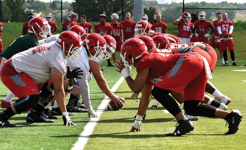 Garrick Hodge/MDN  Minot State's offensive and defensive lines prepare for a snap at a college football practice Thursday in Minot.