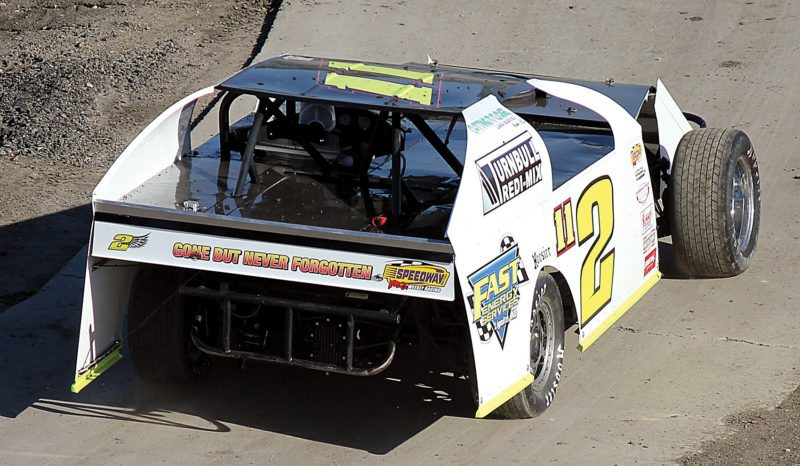 Alex Eisen/MDN Conclusion of tribute laps driven by Steven Pfeifer in memory of Westhope driver Robbie Conway and his No. 2 IMCA Sports Mod machine on Sunday before the weekly races at Nodak Speedway.