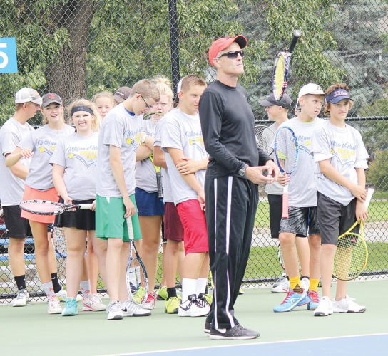 Alex Eisen/MDN Tim Wilkison (in black) leads one of the drills Thursday in the Road to the U.S. Open camp put on by the Marc White Tennis Academy at Hammond Park.