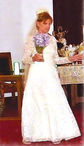 Submitted Photo   Ruth Ganes models her mother's wedding gown from May 1940. Ganes will be a model in a fashion show to be presented during Ladies Day at The Sibyl Center in Stanley on Aug. 26.