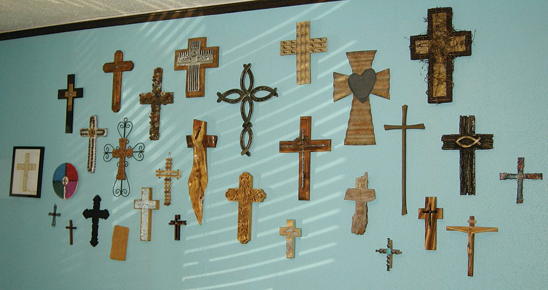 Pastor has collection of interesting crosses on office wall