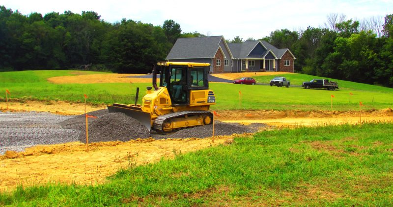 Morning Journal/Larry Shields A bulldozer operated by Bob Coppock of Coppock Excavating Contractors of Rogers lays in the gravel bed for a new street called Red Tail Drive in The Retreat.