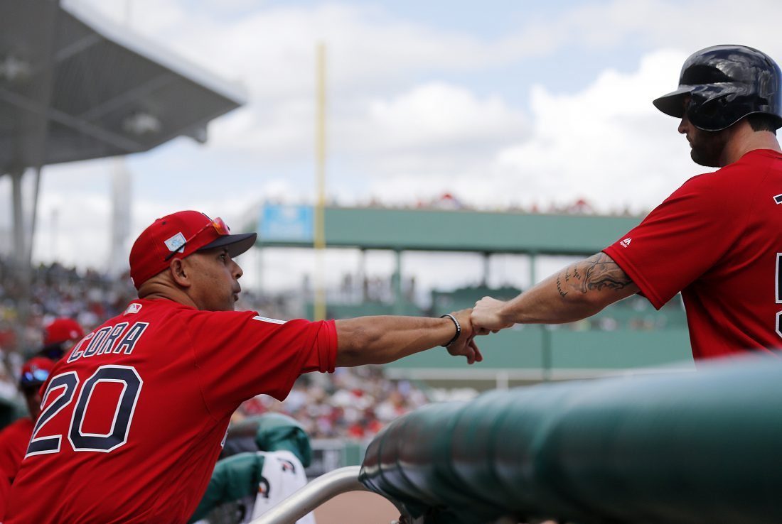 4d2f6ae1195f7 Boston Red Sox manager Alex Cora (20) greets Sam Travis after he scored on a  single off the bat of Juan Centeno in the eighth inning of their spring ...