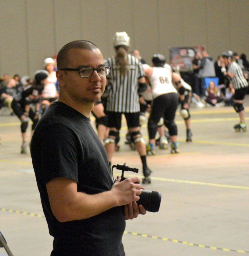 Joe Woody Focusing His Cameras For Derby Girls Documentary News