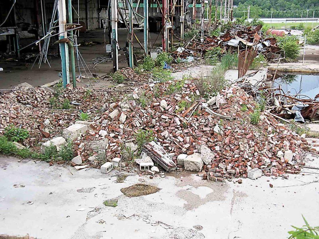 Pile Of Building Debris : Johns manville debris removal nearing completion news