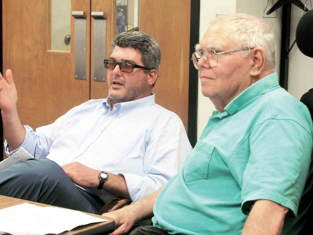 Photo by Evan Bevins Parkersburg Mayor Tom Joyce, left, discusses a proposed outdoor dining ordinance during Thursday's City Council Public Works Committee meeting, as Vienna resident Warren Peascoe, who expressed concerns about the ordinance, listens.