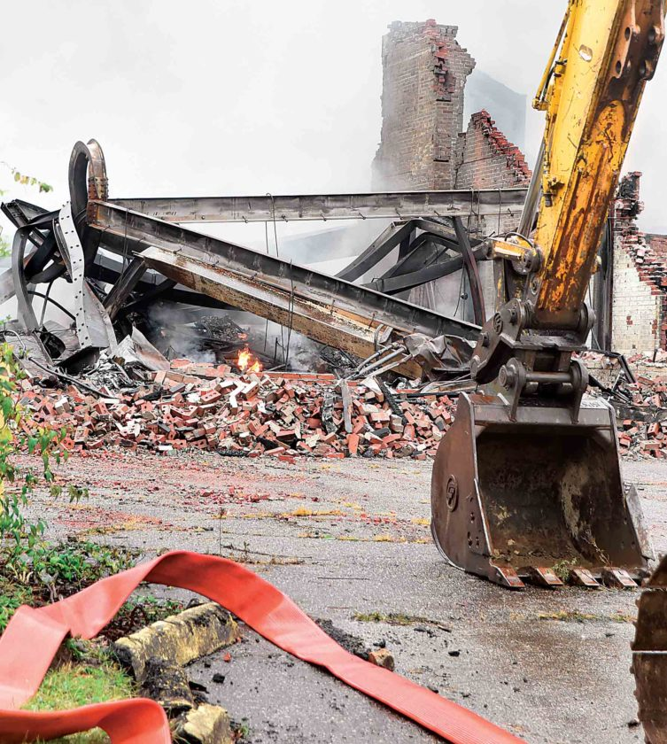 Twisted metal is all that is left of the structures which formed the former Ames Plant, which was destroyed by fire Saturday. (Photo by Jeff Baughan)