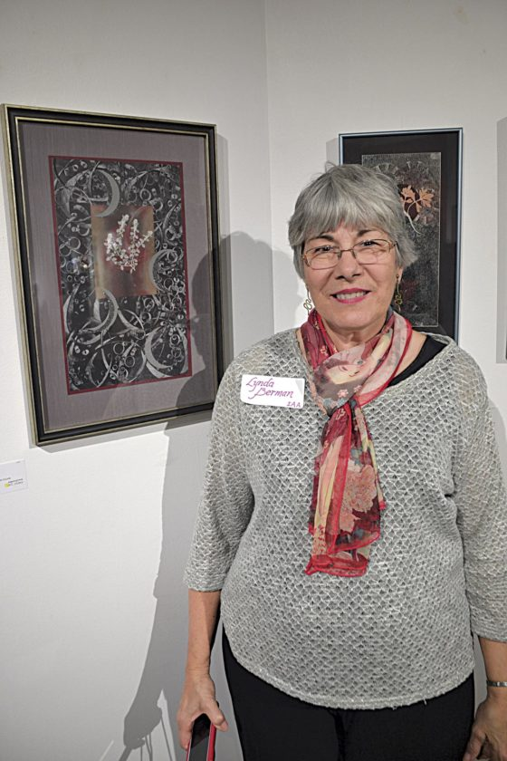 Photo by Brett Dunlap Lynda Berman is one of 11 artists featured in an exhibit from the Innovative Arts Alliance on display at the Parkersburg Art Center. Berman does collages with different types of paper and feature pressed leaves and flowers from her garden.