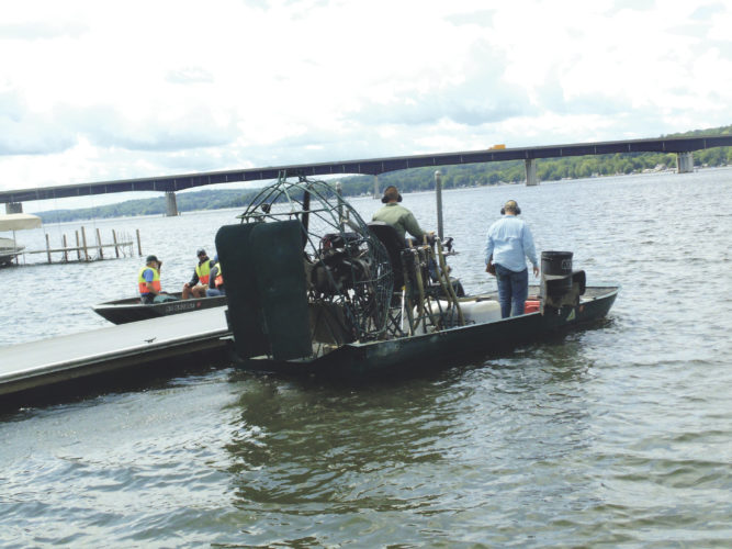Photo by Jimmy McCarthy The spray boat sets out on Chautauqua Lake just after 11 a.m. to begin spraying herbicides in the Bemus Bay area. SOLitude Lake Management conducted the spraying and were accompanied by state Department of Environmental Conservation personnel, with their boat pictured to the left.