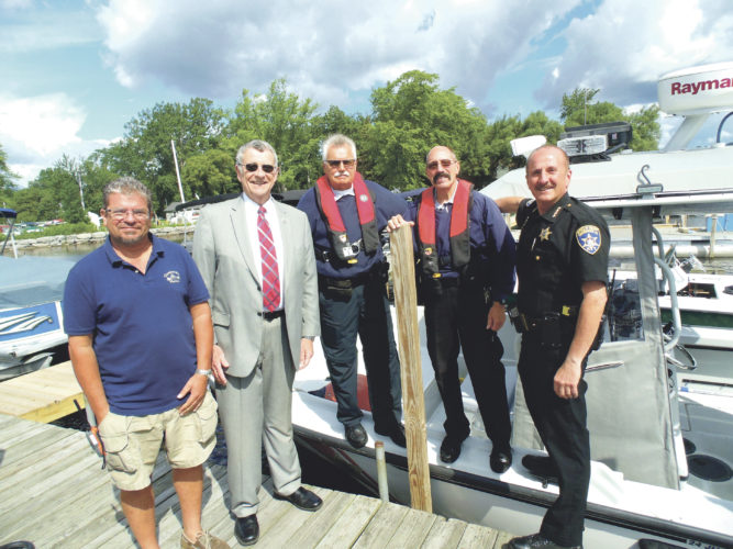 Photo by Jimmy McCarthy Local officials are urging boaters, kayakers and other water users to wear a flotation device this summer. Pictured from the left are Ken Shearer, president of Chautauqua Marina; County Executive Vince Horrigan; Chautauqua County navigational deputies Greg Paterniti and Robert Richter; and Sheriff Joe Gerace.