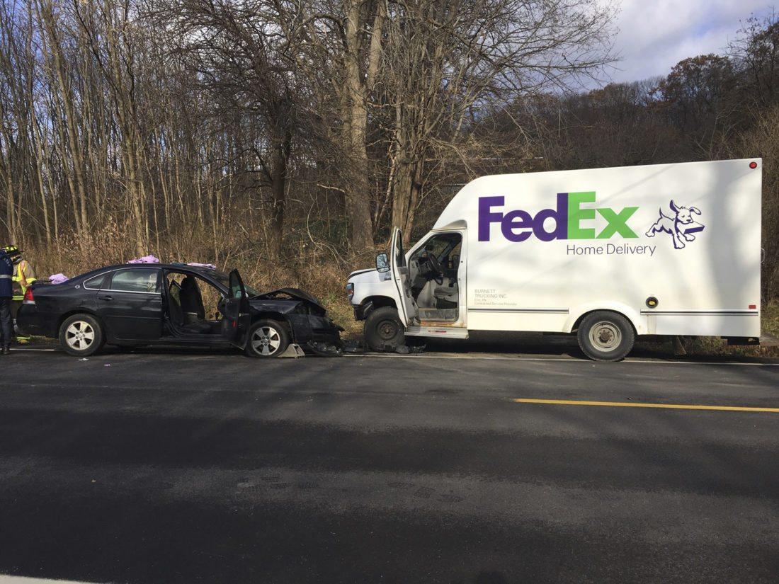Car slams into parked FedEx truck | News, Sports, Jobs