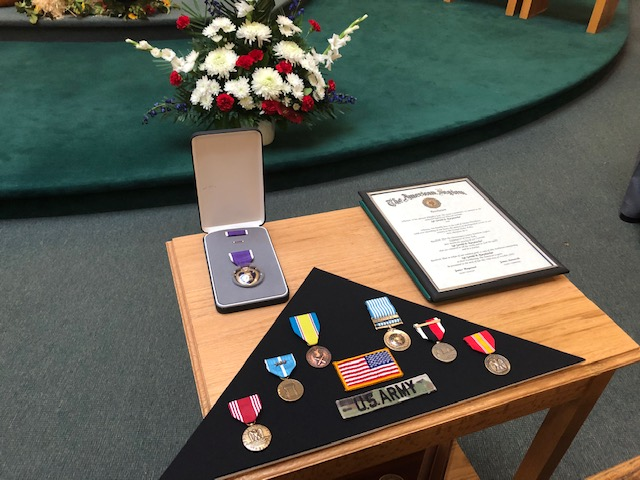 Family members of Sgt. Gerald Raeymacker were presented with his honors and medals during services.