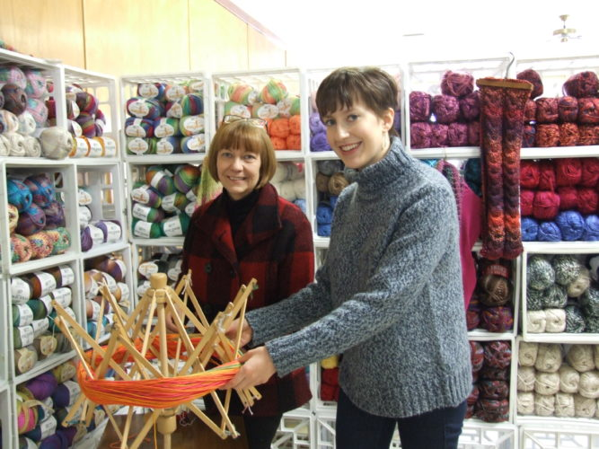 Yarn For Ewe owners Dianne Valvo (left) and her daughter Mary Heyl (right) use a yarn winder in their Randolph store.  Photos by Beverly Kehe-Rowland