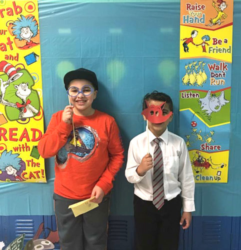 Lincoln Elementary School third grader, Trayce Eggleston, and his brother first grader, Trysten, try out the photo booth at the school's recent Literacy Night.